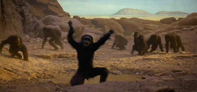 https://postworldgames.files.wordpress.com/2015/10/2001-a-space-odyssey-dawn-of-man-apes.png